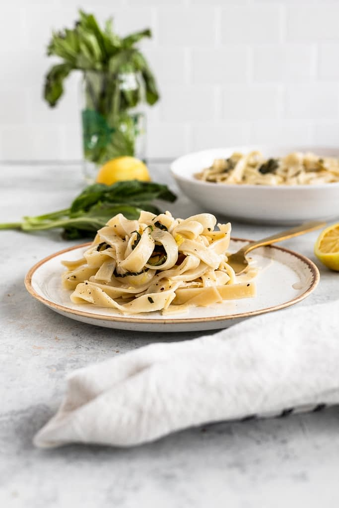 creamy lemon pasta on a separate plate