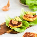 plantain burger on lettuce with aioli and avocado